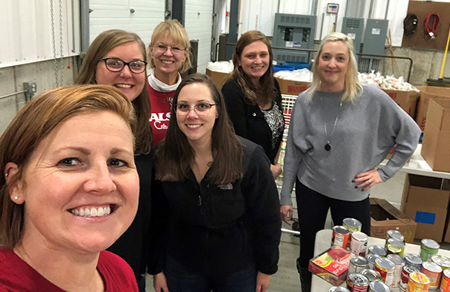 New hires volunteering at Kalamazoo Loaves and Fishes