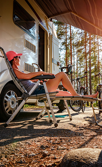Woman relaxing outside RV