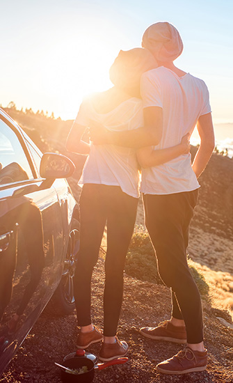 Young couple next to car